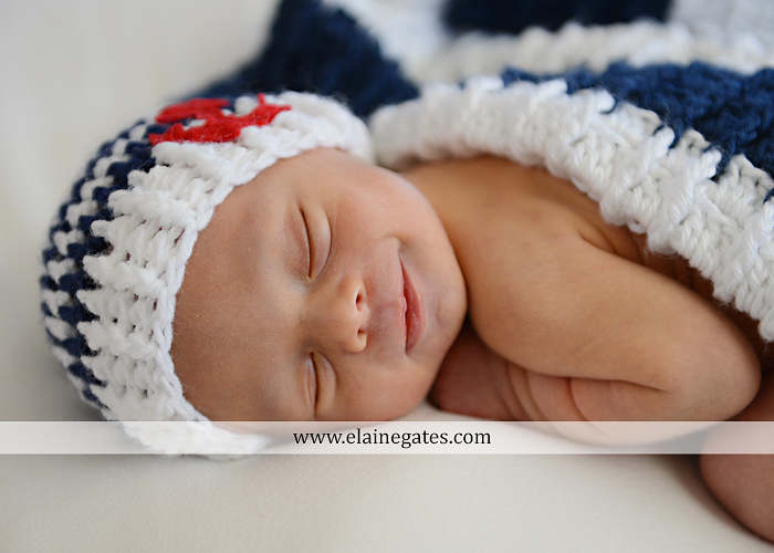 Mechanicsburg Central PA newborn portrait photographer baby sleeping hat football mother child anchor fur blanket hardwood floor vl 5