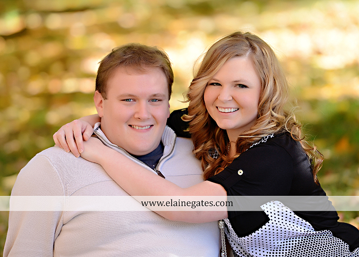 Mechanicsburg Central PA portrait photographer engagement couple hug embrace kiss Boiling Springs lake trees water ducks geese fall na 1