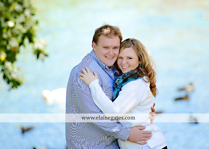 Mechanicsburg Central PA portrait photographer engagement couple hug embrace kiss Boiling Springs lake trees water ducks geese fall na 7