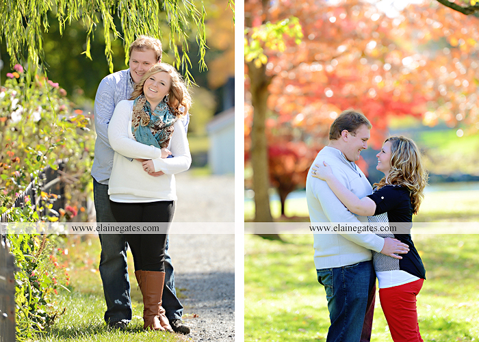 Mechanicsburg Central PA portrait photographer engagement couple hug embrace kiss Boiling Springs lake trees water ducks geese fall na 8