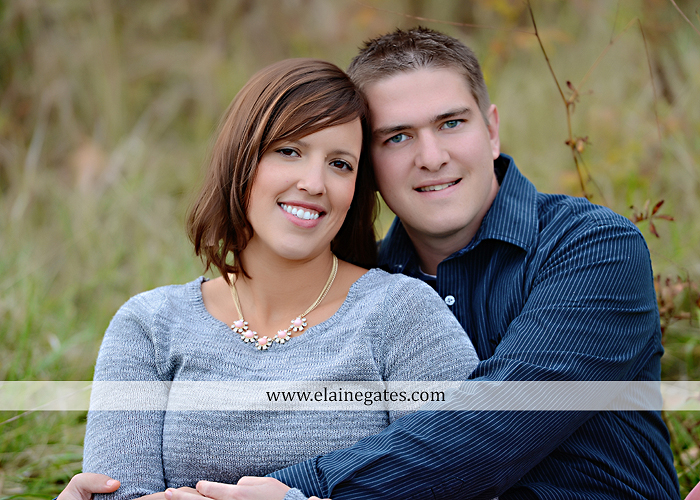 Mechanicsburg Central PA portrait photographer engagement couple ring field trees hug embrace kiss covered bridge water stream creek leaves fall sc 3
