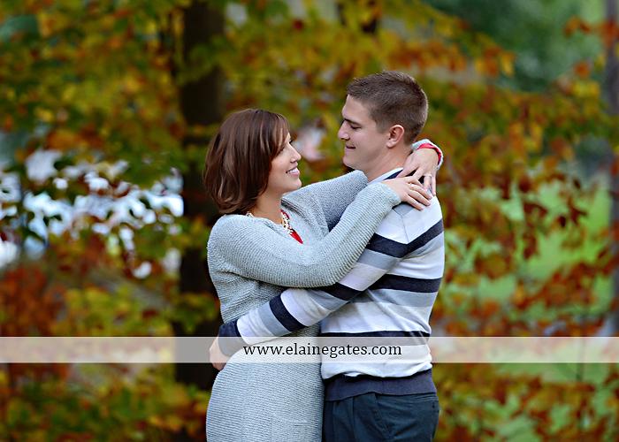 Mechanicsburg Central PA portrait photographer engagement couple ring field trees hug embrace kiss covered bridge water stream creek leaves fall sc 4