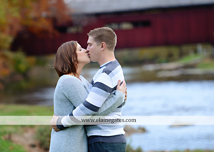 Mechanicsburg Central PA portrait photographer engagement couple ring field trees hug embrace kiss covered bridge water stream creek leaves fall sc 5
