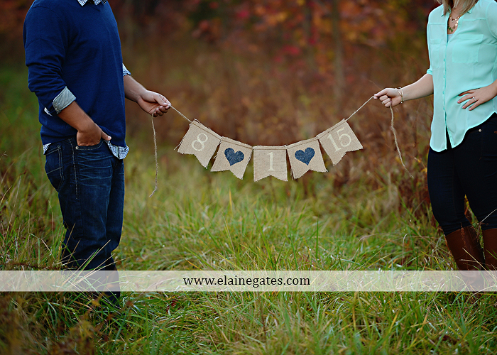 Mechanicsburg Central PA portrait photographer engagement outdoor fall leaves trees couple hug embrace kiss dog covered bridge holding hands field date rocks mpck 11