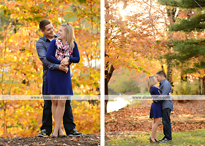 Mechanicsburg central pa portrait photographer engagement outdoor fall leaves trees couple hug embrace kiss dog covered