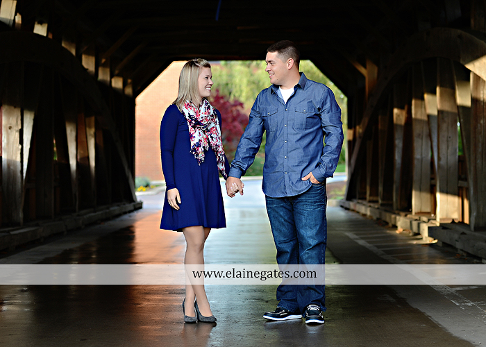 Mechanicsburg Central PA portrait photographer engagement outdoor fall leaves trees couple hug embrace kiss dog covered bridge holding hands field date rocks mpck 5