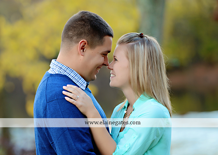 Mechanicsburg Central PA portrait photographer engagement outdoor fall leaves trees couple hug embrace kiss dog covered bridge holding hands field date rocks mpck 7