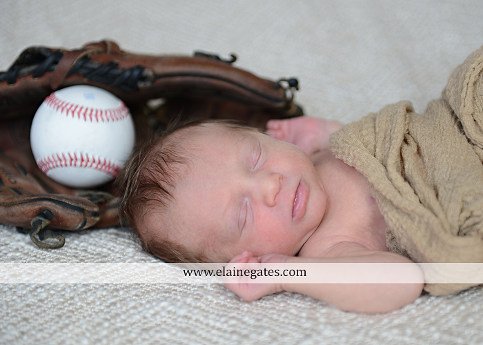Mechanicsburg Central PA newborn portrait photographer baby sleeping blanket mother kiss embrace baseball glove bowls hardwood kb 6