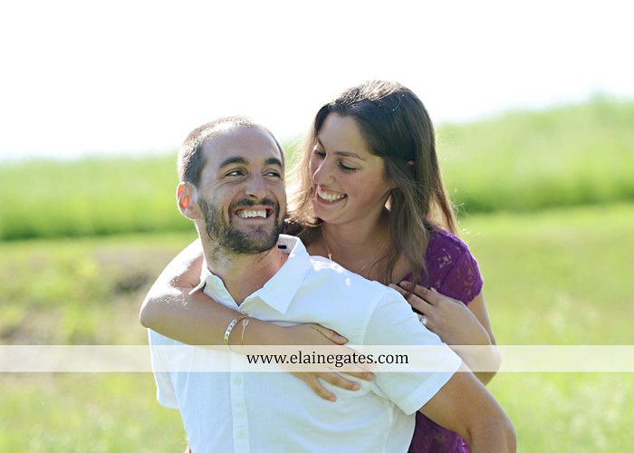 Mechanicsburg Central PA portrait photographer engagement trees fence road grass field kiss hug water stream creek holding hands mb 5