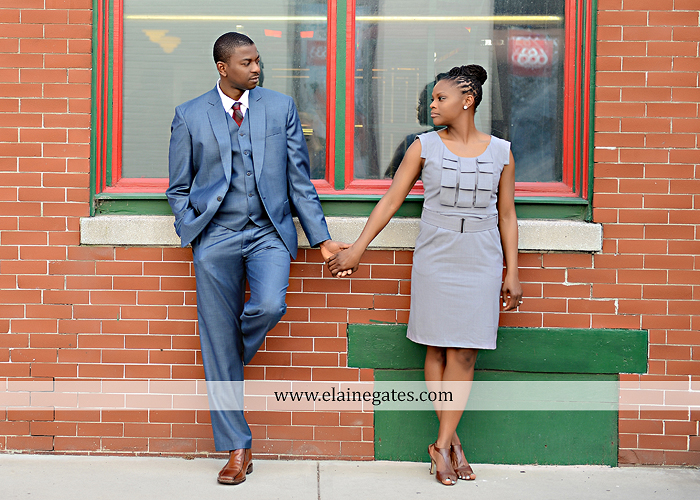 Mechanicsburg Central PA portrait photographer engagement vintage train station brick wall sidewalk city urban window bench luggage suitcase bags railroad tracks vp 3