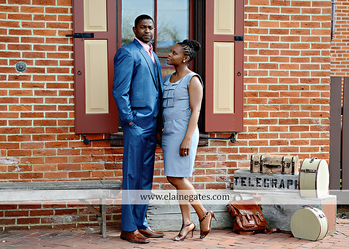 Mechanicsburg Central PA portrait photographer engagement vintage train station brick wall sidewalk city urban window bench luggage suitcase bags railroad tracks vp 5