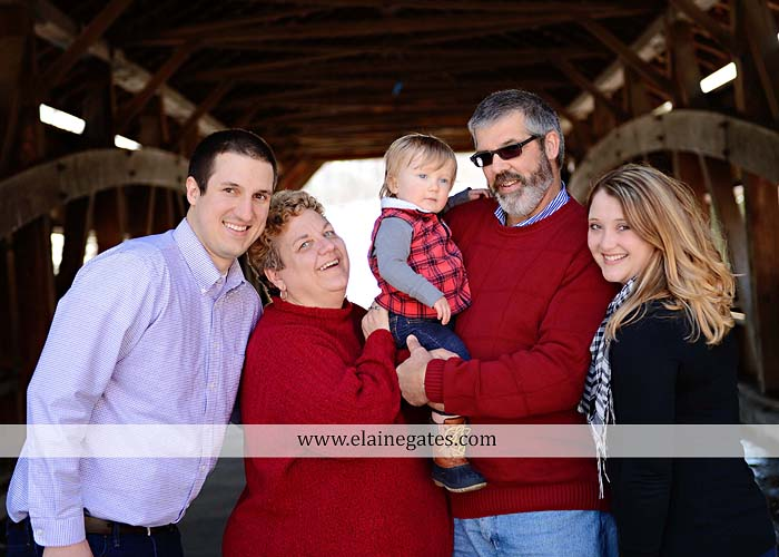 Mechanicsburg Central PA portrait photographer family covered bridge messiah college parents mother father son boy snow trees kiss jk 3