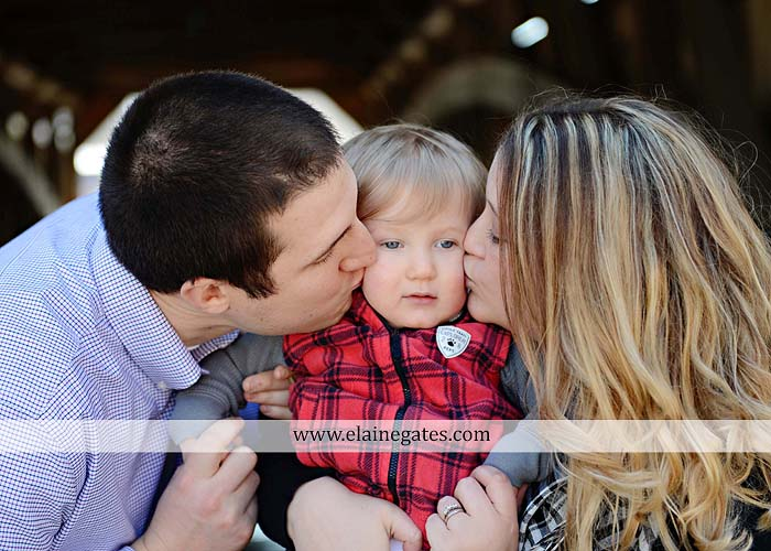 Mechanicsburg Central PA portrait photographer family covered bridge messiah college parents mother father son boy snow trees kiss jk 6