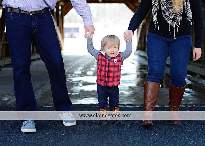 Mechanicsburg Central PA portrait photographer family covered bridge messiah college parents mother father son boy snow trees kiss jk 7