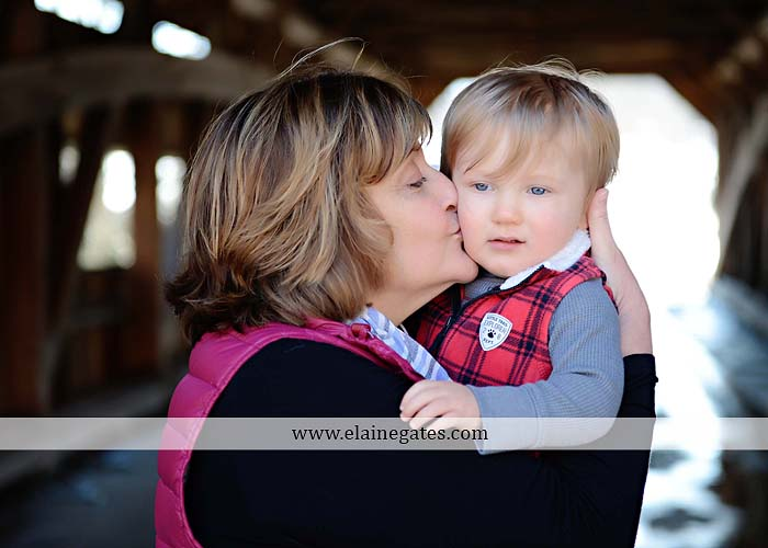 Mechanicsburg Central PA portrait photographer family covered bridge messiah college parents mother father son boy snow trees kiss jk 8