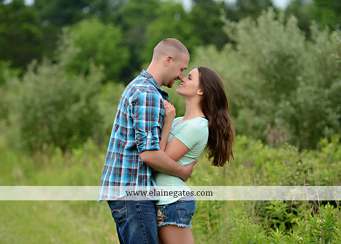 Mechanicsburg Central PA portrait photographer engagement outdoor couple water trees grass field dock water lake fishing lure boat holding hands picnic basket kiss path ph 01