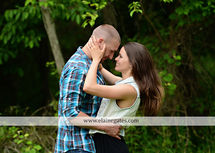 Mechanicsburg Central PA portrait photographer engagement outdoor couple water trees grass field dock water lake fishing lure boat holding hands picnic basket kiss path ph 08