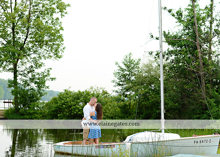 Mechanicsburg Central PA portrait photographer engagement outdoor couple water trees grass field dock water lake fishing lure boat holding hands picnic basket kiss path ph 09