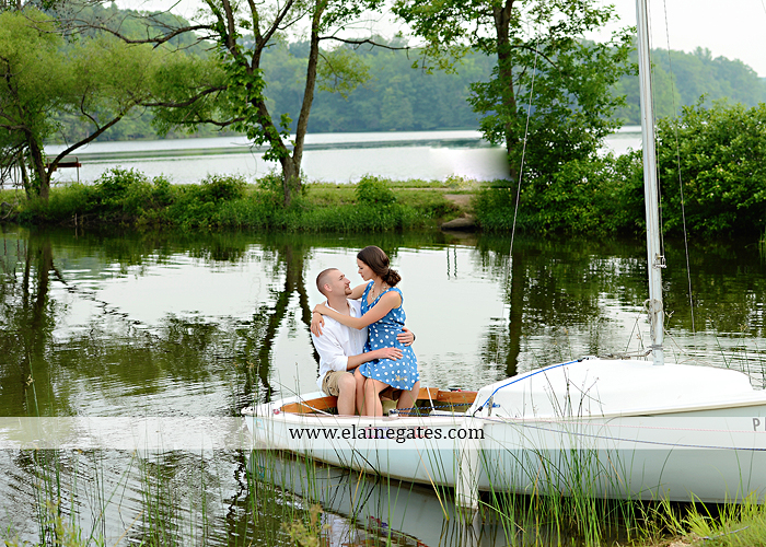 Mechanicsburg Central PA portrait photographer engagement outdoor couple water trees grass field dock water lake fishing lure boat holding hands picnic basket kiss path ph 11