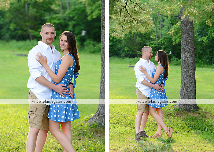 Mechanicsburg Central PA portrait photographer engagement outdoor couple water trees grass field dock water lake fishing lure boat holding hands picnic basket kiss path ph 19