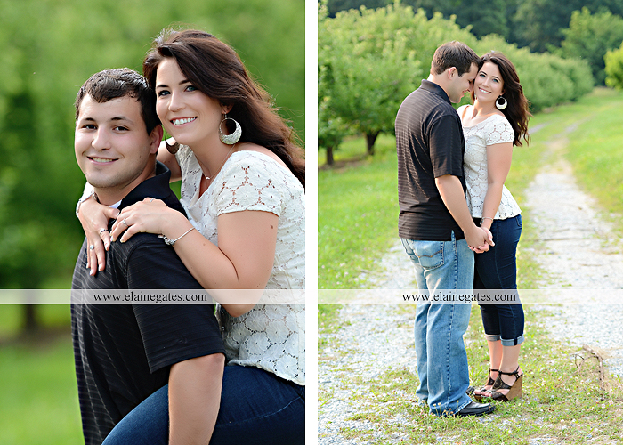 Mechanicsburg Central PA engagement portrait photographer outdoor fence trees field road path barn door ivy wildflowers kiss 03