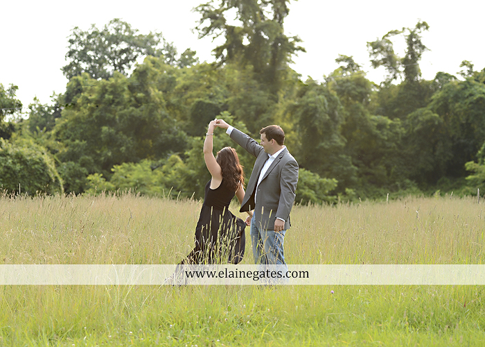 Mechanicsburg Central PA engagement portrait photographer outdoor fence trees field road path barn door ivy wildflowers kiss 04