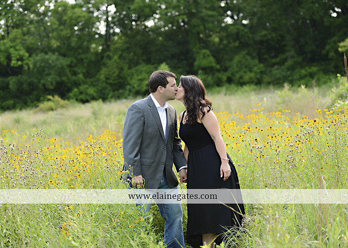 Mechanicsburg Central PA engagement portrait photographer outdoor fence trees field road path barn door ivy wildflowers kiss 12