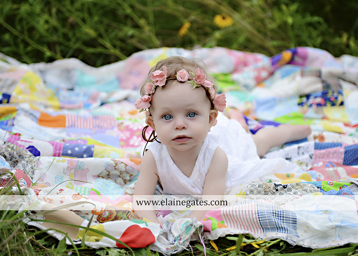 Mechanicsburg Central PA newborn baby portrait photographer girl outdoor field wildflowers blanket quilt mother father daughter path headband kiss rp 04