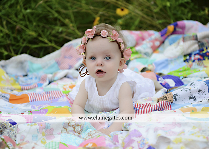 Mechanicsburg Central PA newborn baby portrait photographer girl outdoor field wildflowers blanket quilt mother father daughter path headband kiss rp 07