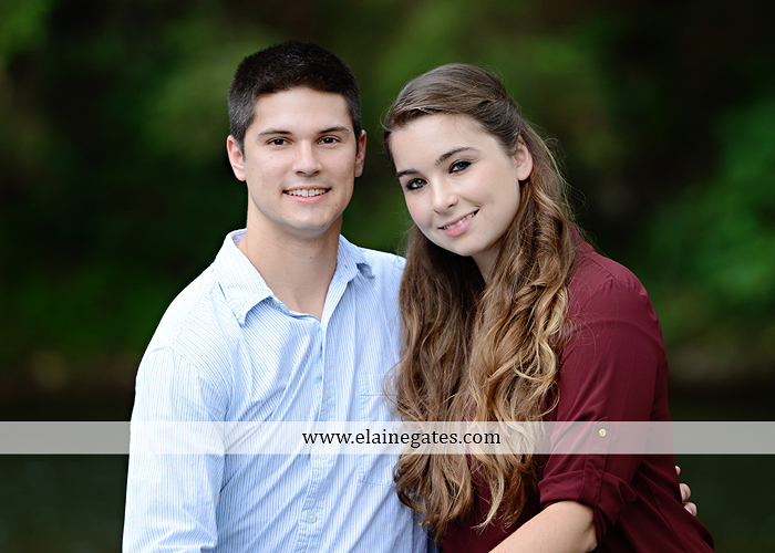 Mechanicsburg Central PA engagement portrait photographer outdoor fence trees field road water stream creek kiss barn farm holding hands nw 06