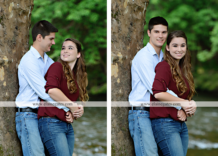 Mechanicsburg Central PA engagement portrait photographer outdoor fence trees field road water stream creek kiss barn farm holding hands nw 07