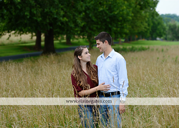 Mechanicsburg Central PA engagement portrait photographer outdoor fence trees field road water stream creek kiss barn farm holding hands nw 09