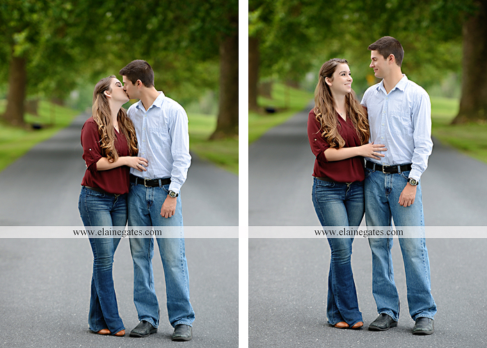 Mechanicsburg Central PA engagement portrait photographer outdoor fence trees field road water stream creek kiss barn farm holding hands nw 10