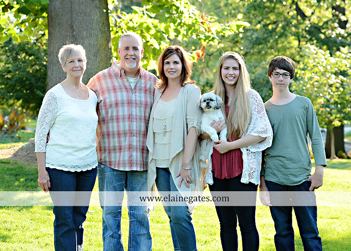 Mechanicsburg Central PA family portrait photographer outdoor carlisle dickinson college mother father sister brother parents dog trees grass stone wall adirondack chair mt 02