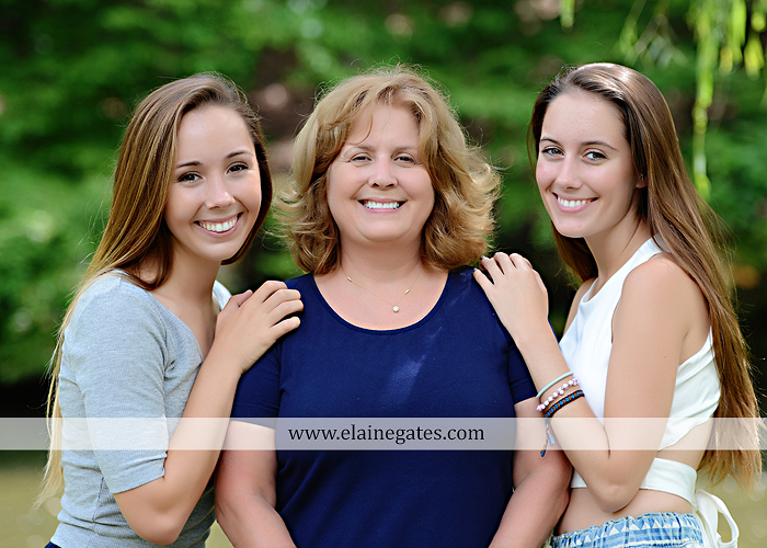 Mechanicsburg Central PA senior portrait photographer outdoor female girl formal wildflowers road field water stream creek bridge stone wall tree shore sister mother rocks fence grass mr 11