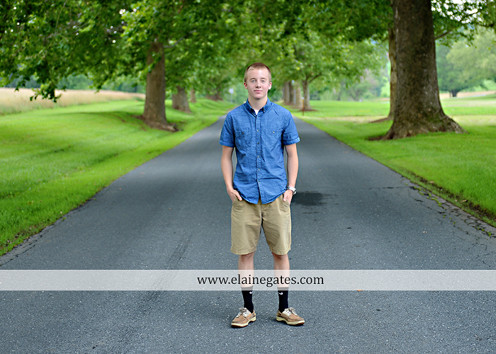 Mechanicsburg Central PA senior portrait photographer outdoor male guy tree grass dog road sister field water stream creek fence american flag usa wrestling singlet zk 03