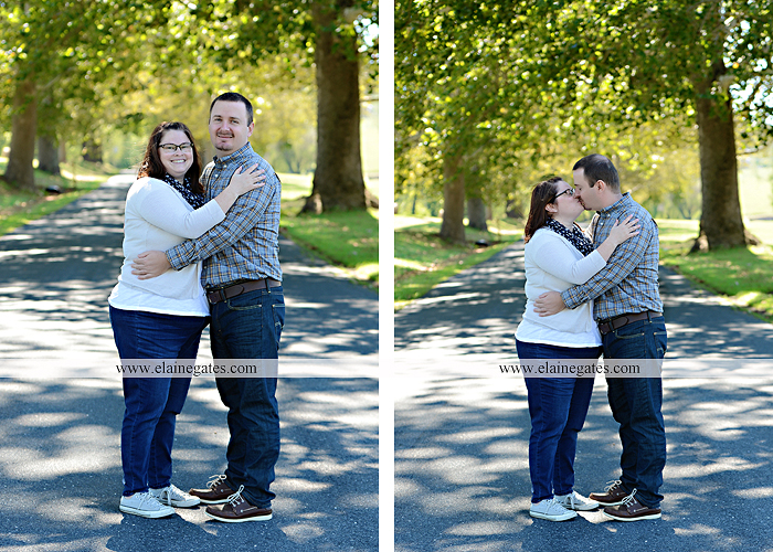 Mechanicsburg Central PA engagement portrait photographer outdoor road trees field hay bale fence water stream creek couple kiss hug holding hands ce 01