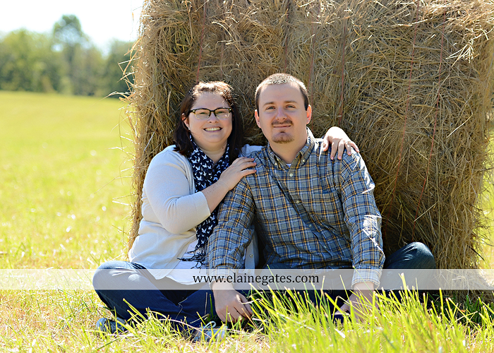 Mechanicsburg Central PA engagement portrait photographer outdoor road trees field hay bale fence water stream creek couple kiss hug holding hands ce 03