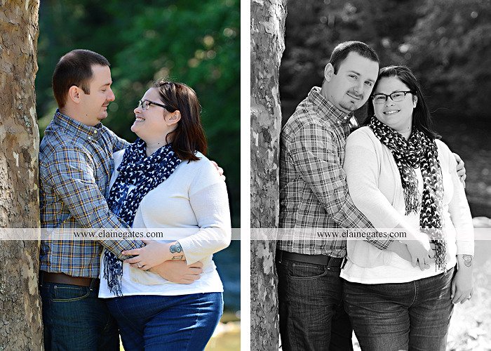 Mechanicsburg Central PA engagement portrait photographer outdoor road trees field hay bale fence water stream creek couple kiss hug holding hands ce 04
