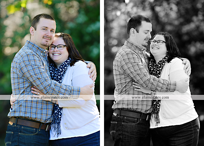 Mechanicsburg Central PA engagement portrait photographer outdoor road trees field hay bale fence water stream creek couple kiss hug holding hands ce 08