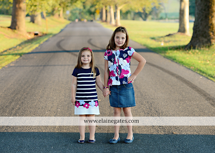 Mechanicsburg Central PA kids children portrait photographer outdoor girls sisters fence grass field trees water stream creek rocks road hay bail sh 09