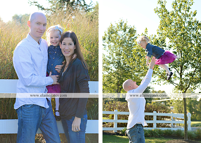 Mechanicsburg Central PA family portrait photographer outdoor girl toddler mother father sidewalk fence grass field kiss rocks az 01