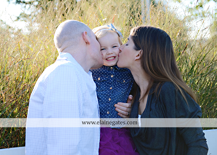 Mechanicsburg Central PA family portrait photographer outdoor girl toddler mother father sidewalk fence grass field kiss rocks az 02