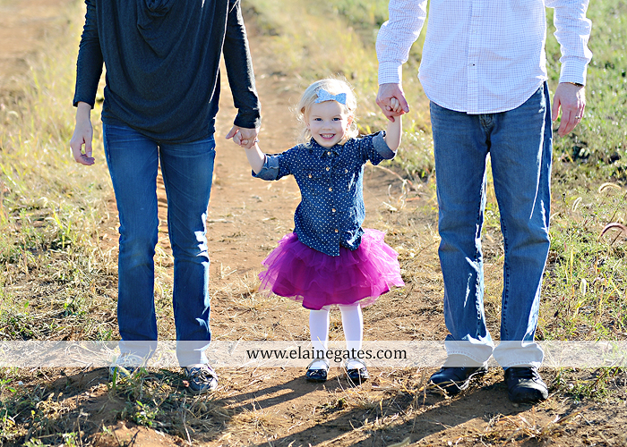 Mechanicsburg Central PA family portrait photographer outdoor girl toddler mother father sidewalk fence grass field kiss rocks az 04