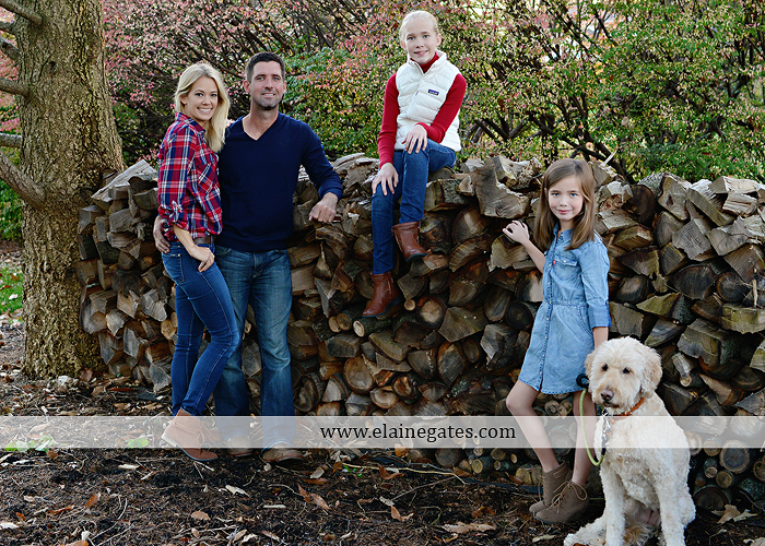 Mechanicsburg Central PA family portrait photographer outdoor girls daughters sisters dog husband wife mother father wood pile leaves trees eg 1