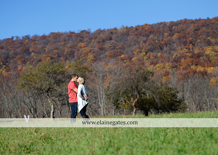 Mechanicsburg Central PA engagement portrait photographer outdoor barn fence field trees leaves dog hockey jersey baseball jersey new york yankees washington capitals bride groom mh 5