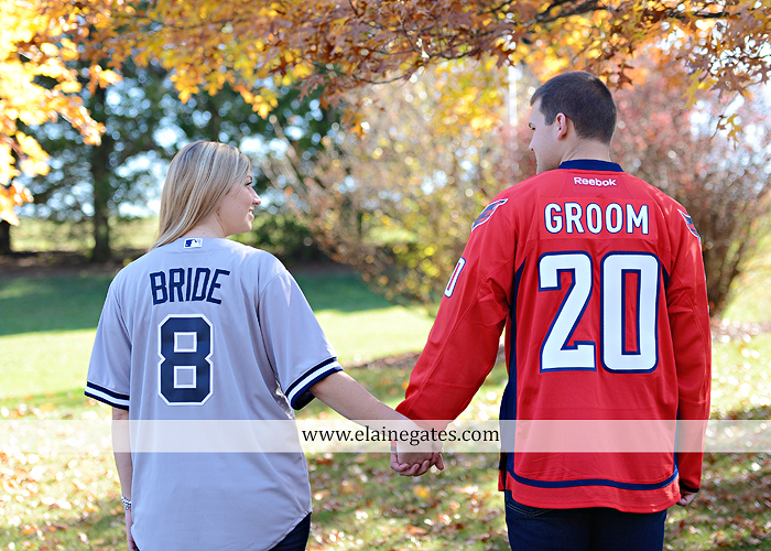 Mechanicsburg Central PA engagement portrait photographer outdoor barn fence field trees leaves dog hockey jersey baseball jersey new york yankees washington capitals bride groom mh 8