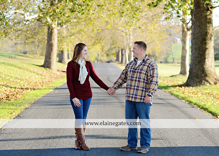 Mechanicsburg Central PA engagement portrait photographer outdoor road trees leaves fence water stream creek ring fishing hook rod hay bale hug kiss kk 01