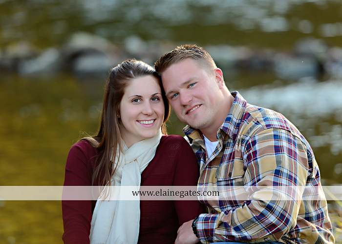 Mechanicsburg Central PA engagement portrait photographer outdoor road trees leaves fence water stream creek ring fishing hook rod hay bale hug kiss kk 04
