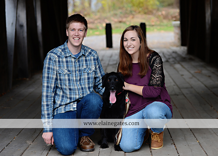 Mechanicsburg Central PA engagement portrait photographer outdoor water river trees leaves rocks dog path pumpkins covered bridge steps stone barn kiss kg 08